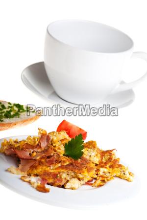 scrambled eggs and bun on a
