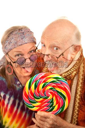 hippie seniors licking a lollipop