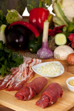 two raw veal chips and various