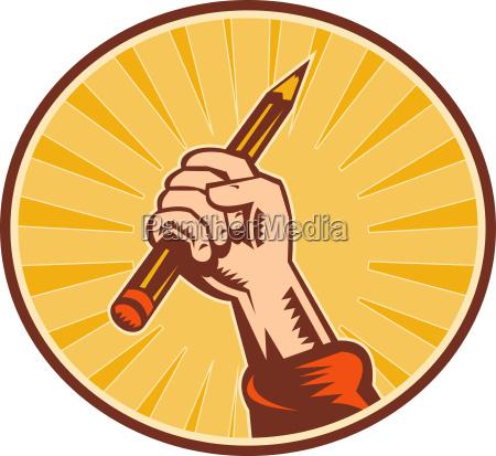 hand holding pencil with sunburst