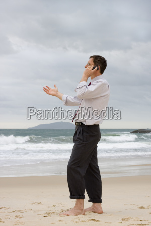 manager phoned on the beach