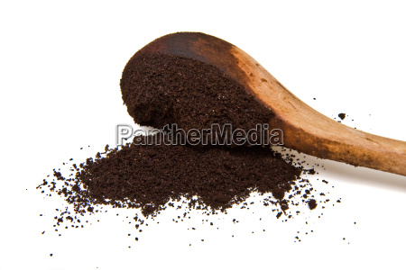 ground coffee and wood scoop