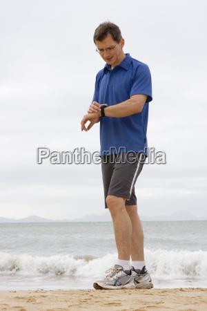 jogger looks at pulse clock