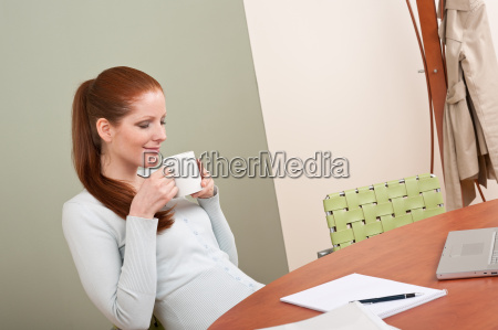 long red hair woman at office