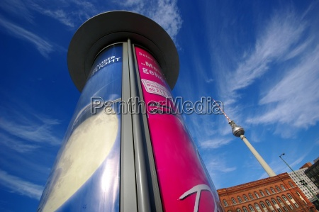 advertising column with television tower berlin