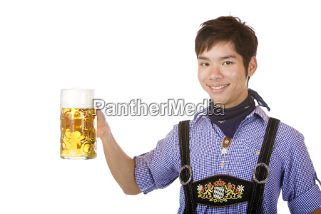 smiling asian holding oktoberfest beer stein