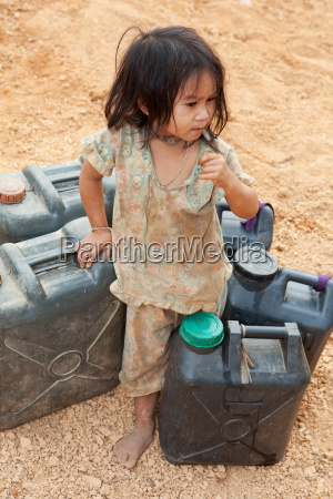 asian child with benzine canister