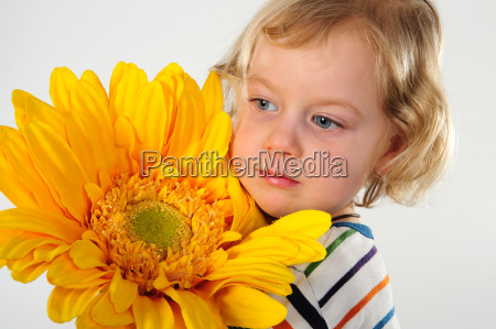 little, girl, with, sunflower - 2811377