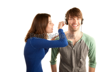 pretty young woman interupts man with