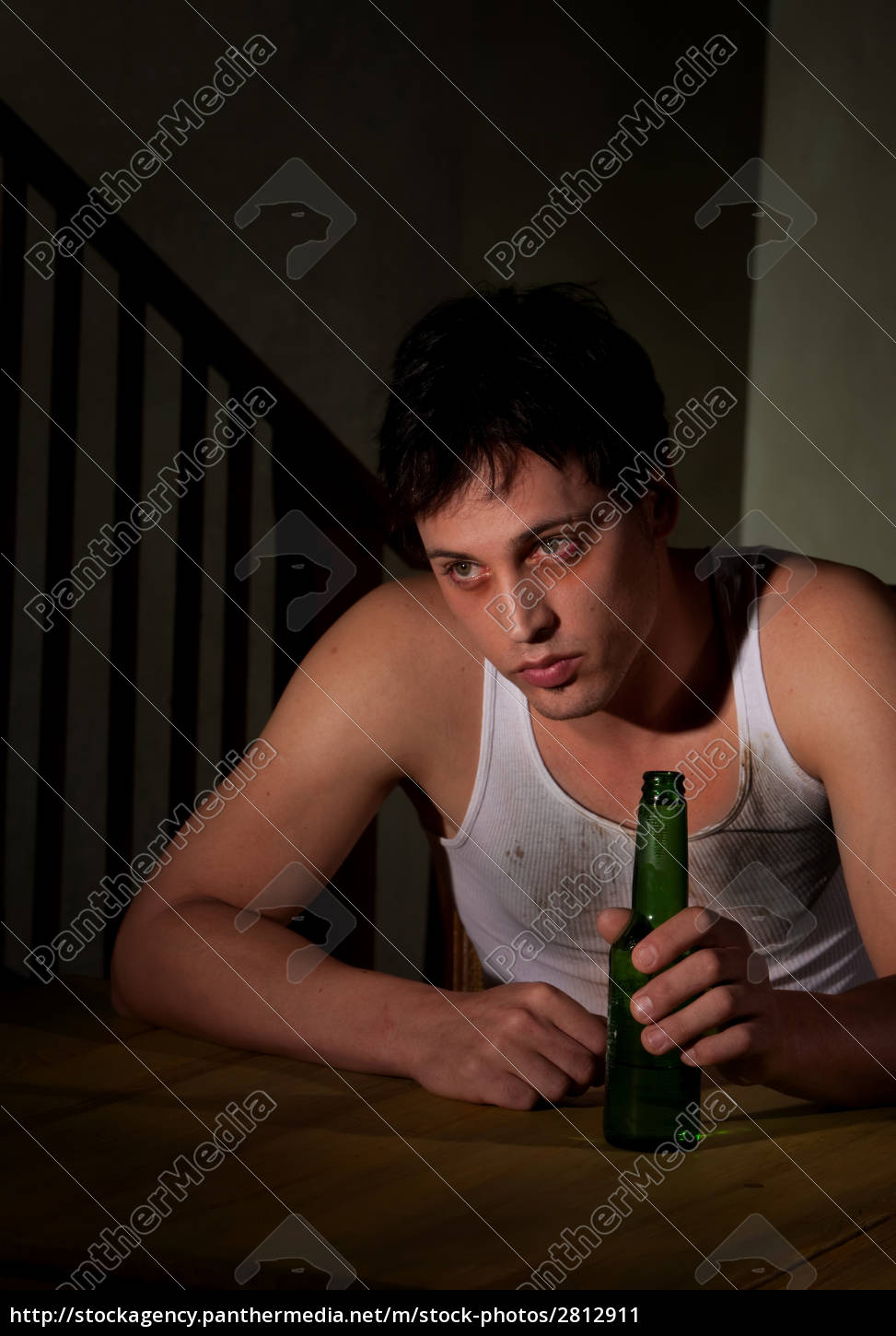 depressed, young, man, with, bottle, of - 2812911