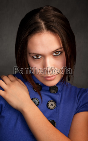 pretty young woman in a blue