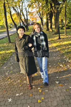 granddaughter, walking, with, grandmother - 2814627