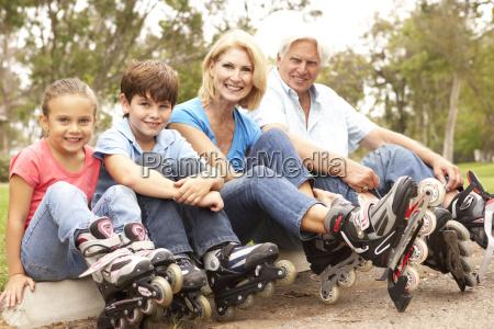 grandparents and grandchildren putting on in