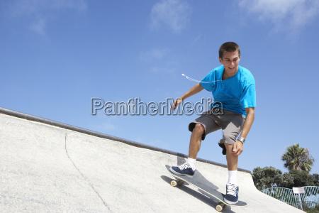 teenage boy in skateboard park