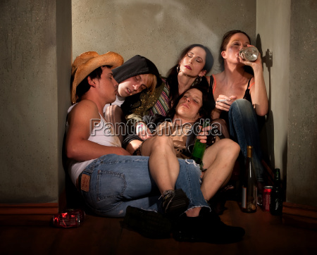 partygoers surrounded by booze bottles in