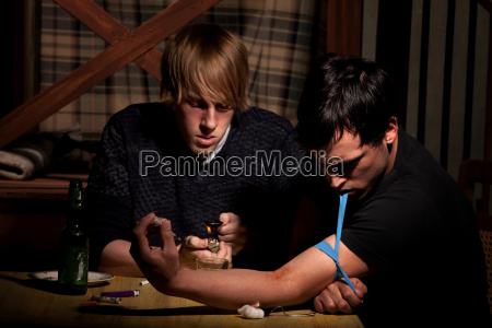 two men with heroin cooking in