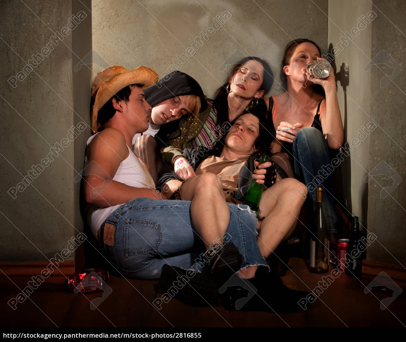 partygoers, surrounded, by, booze, bottles, in - 2816855