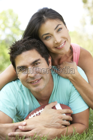 couple, in, park, with, american, football - 2818873