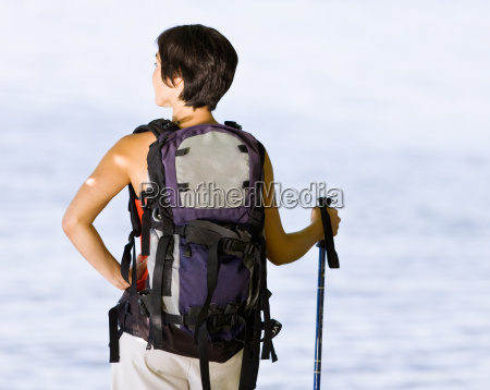 woman hiking with backpack and walking