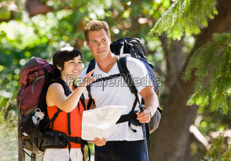 couple, with, backpacks, looking, at, map - 2822989