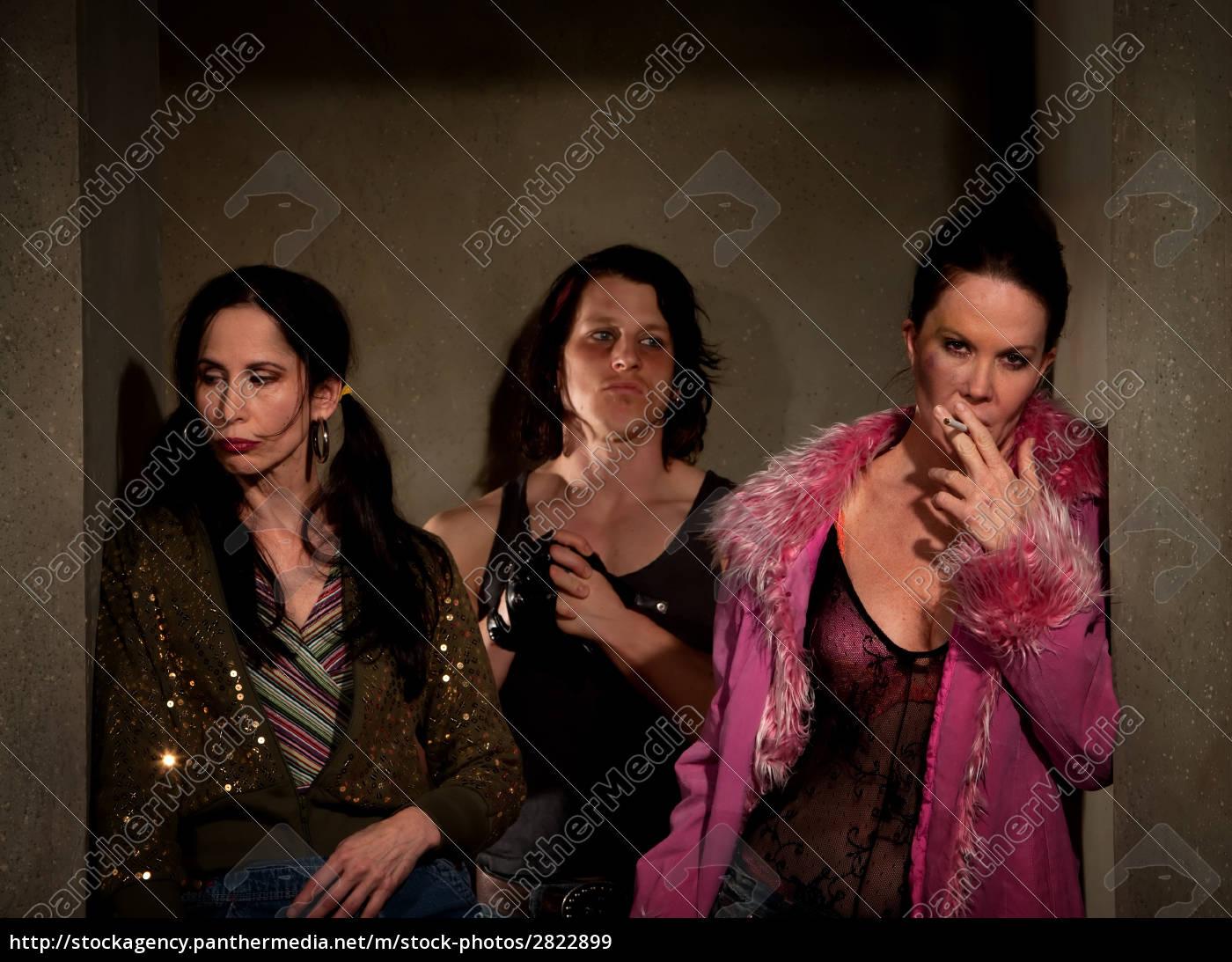 frightened, prostitutes, in, hallway, with, pimp - 2822899