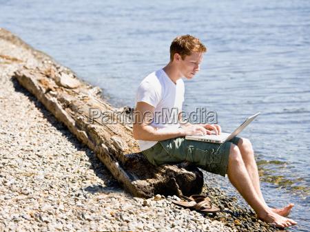 man, using, laptop, near, stream - 2822683