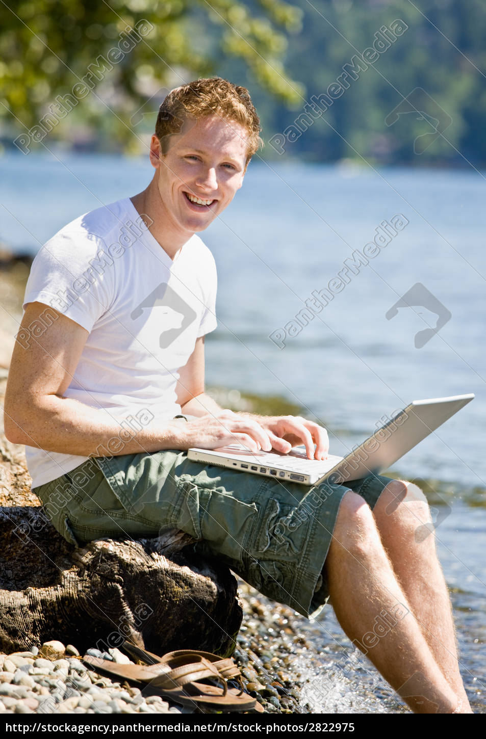 man, using, laptop, near, stream - 2822975