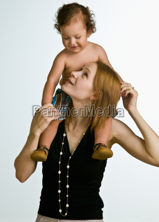 mother, carrying, son, on, shoulders - 2822575
