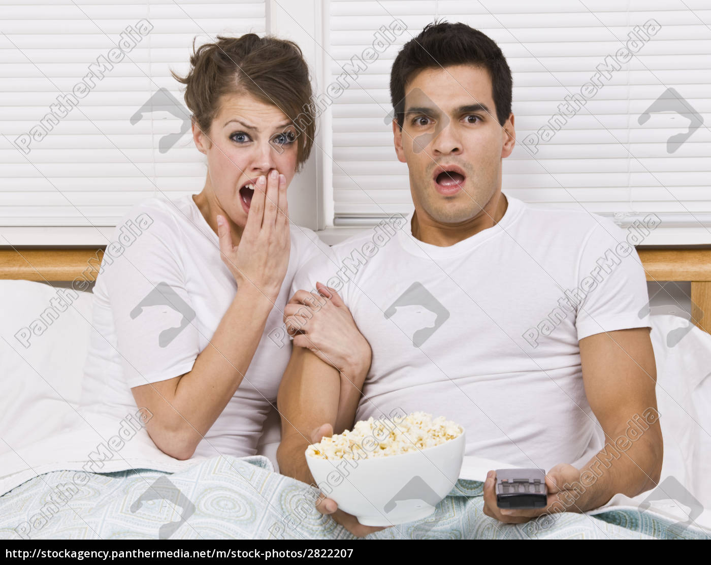 surprised, young, couple, watching, tv - 2822207
