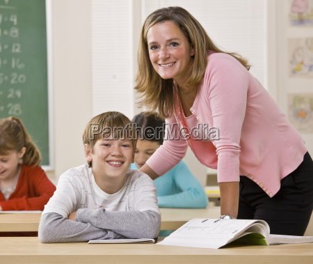 teacher, helping, student, in, classroom - 2822487