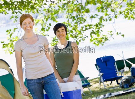 women, carrying, cooler, at, campsite - 2822907