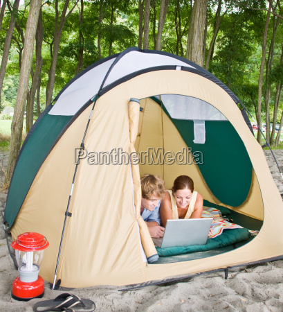 couple, in, tent, using, laptop - 2823571