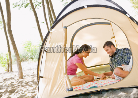 couple, playing, boardgame, in, tent - 2823595