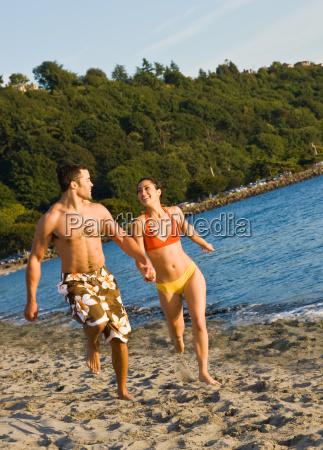 couple, running, on, beach - 2823549