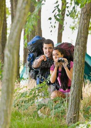 couple, with, backpacks, and, binoculars, outdoors - 2823809