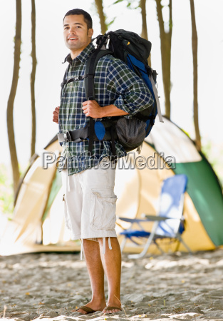 man, carrying, backpack, at, campsite - 2823833