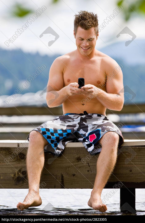 man, sitting, on, pier, text, messaging - 2823305