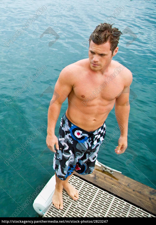 man, standing, on, pier, at, lake - 2823247