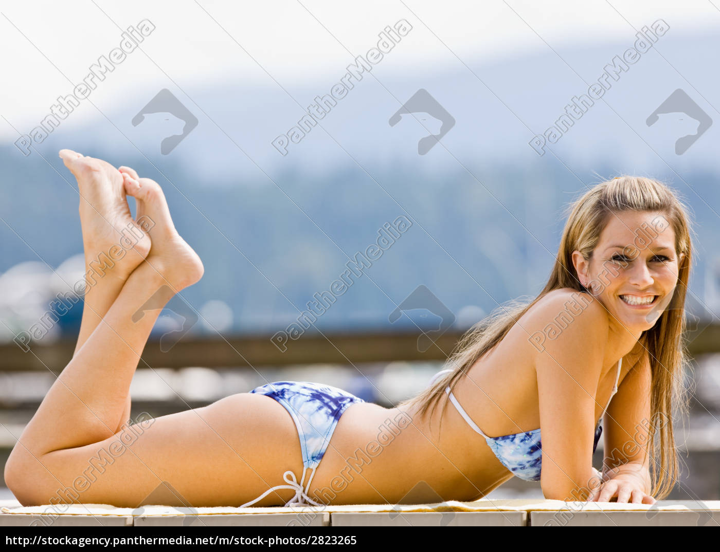 woman, laying, on, pier - 2823265