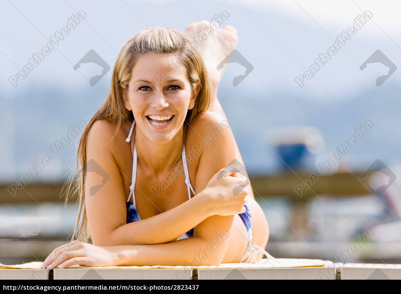 woman, laying, on, pier - 2823437