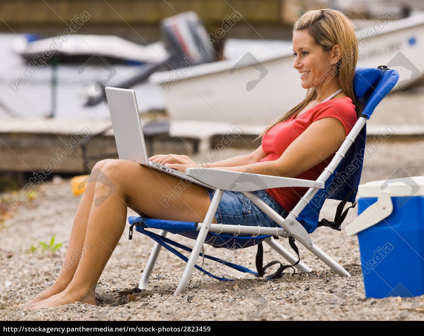 woman, using, laptop, on, beach - 2823459