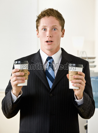 businessman, holding, paper, coffee, cups - 2824257