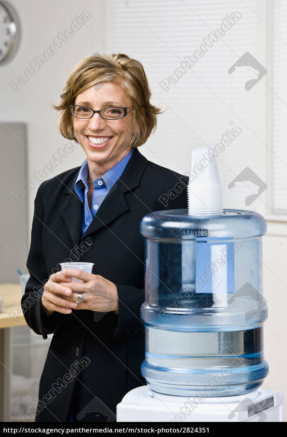 businesswoman, getting, water, from, water, cooler - 2824351