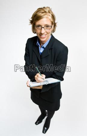 businesswoman, writing, on, clipboard - 2824299