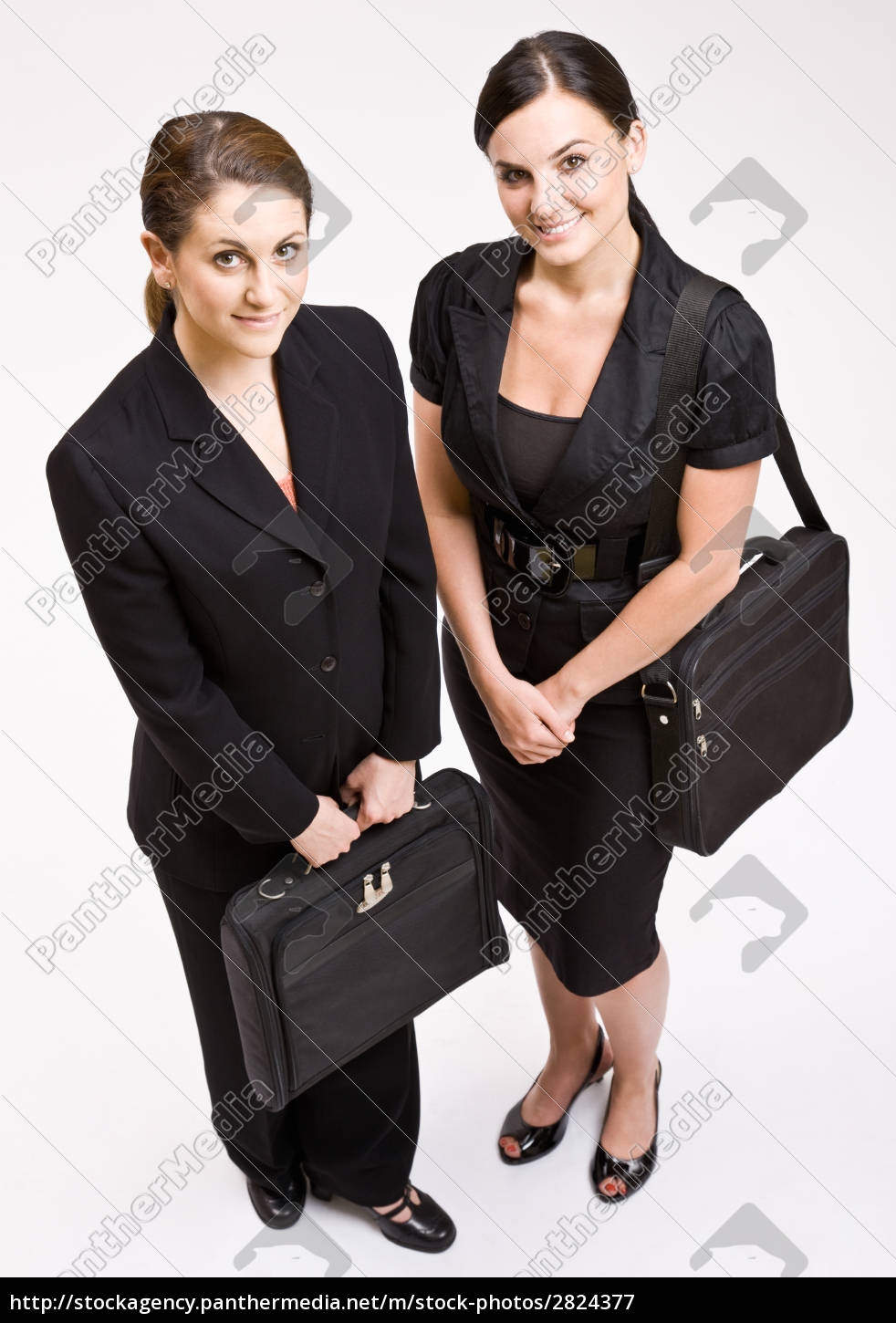 businesswomen, carrying, briefcases - 2824377