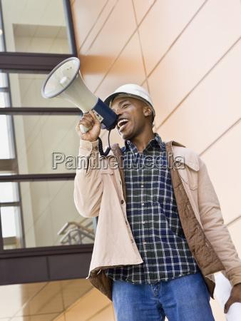 male, construction, worker, using, bullhorn - 2824409