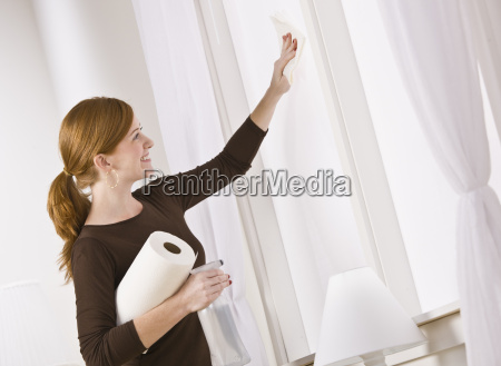 attractive woman cleaning window