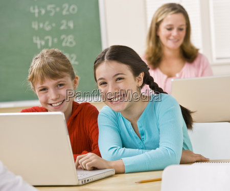 girls, using, laptop, in, classroom - 2832751