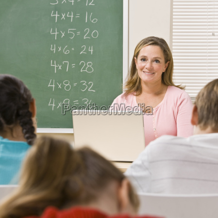 teacher, with, laptop, in, classroom - 2832985
