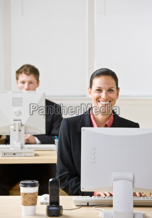 business people typing on computers